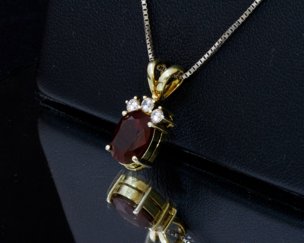 Large Red Burmese Ruby Pendant accented with 3 White Sapphire Stones